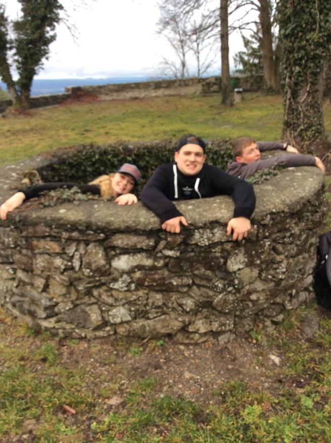 Sister Hancock, Elder Liechty, and Elder Sorenson falling down a well at Hohentwiel