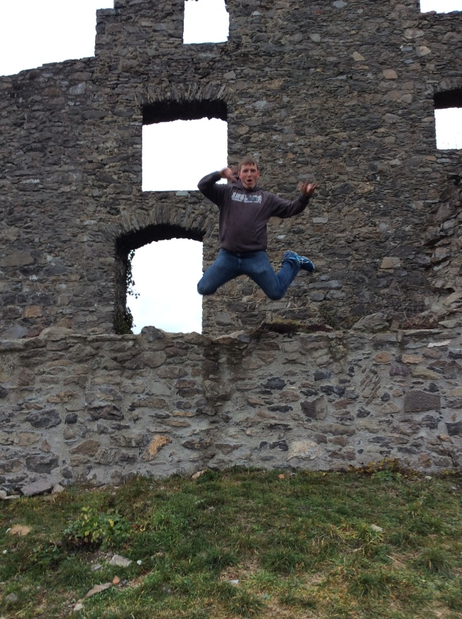 Elder Sorenson jumping off of a brick wall at Hohentwiel