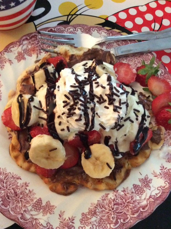 "Ralph asked us what we wanted for breakfast for GMK. We said, ""Waffles with nutella, eis, strawberries, raspberries, bananas, whipped cream, and sprinkles"" so guess what we had! XD"