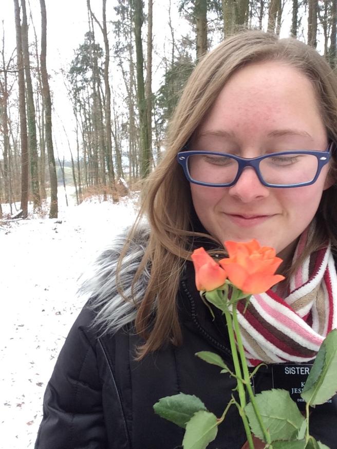 Megan walking through the snowy woods